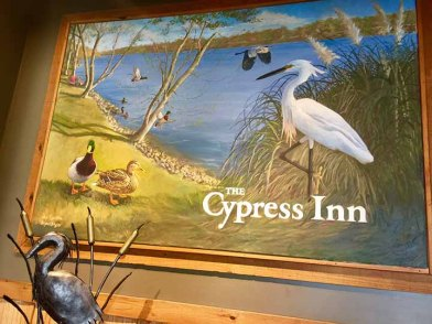Welcome sign at The Cypress Inn