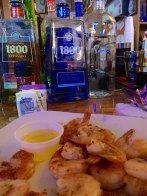 The Capitol Oyster Bar serves fantastic fresh shrimp. And, yep liqour on a Sunday!