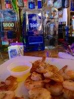 The Capitol Oyster Bar serves fantastic fresh shrimp. And, yep liqour on a Sunday!
