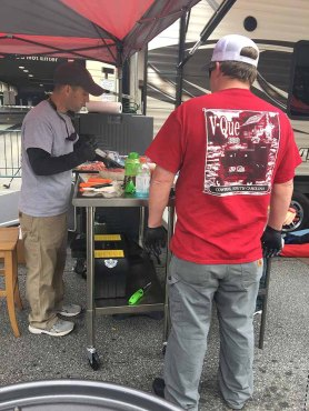 V-Que BBQ preparing for the next day's competition at Hub City Hog Fest 2018
