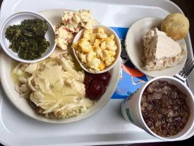 Collard Greens, Potato Salad, Macaroni and Cheesem Cranberries, Turkey and Gravy, Peanut Butter Pie, Yeast Roll, and necessary Diet Coke,Wades
